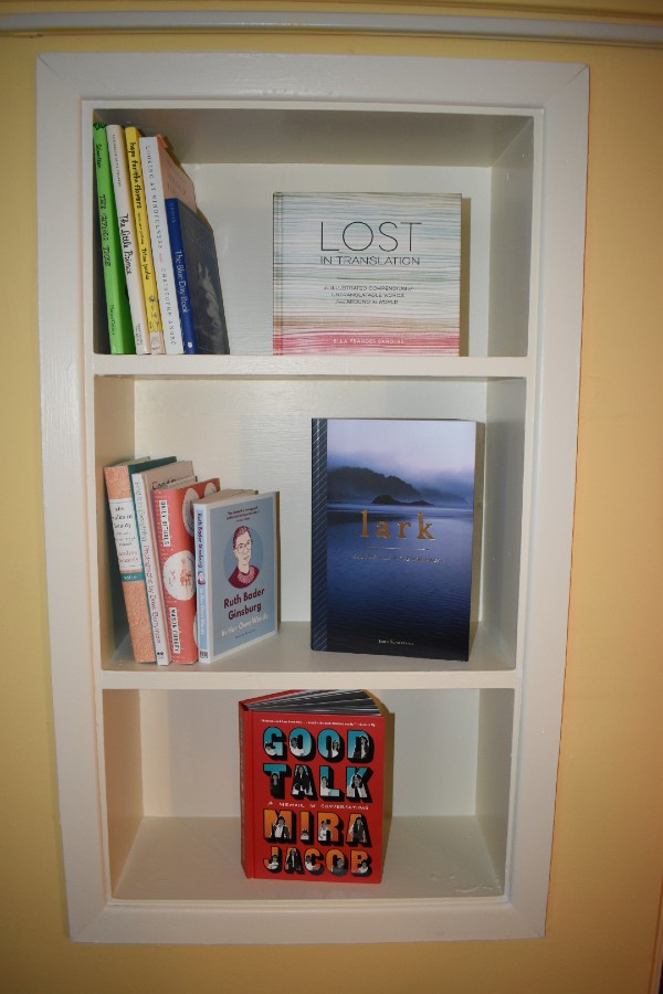 Therapeutic book collection in wall shelves
