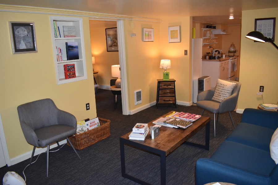 Lisa Kothari's Seattle therapy practice, cozy with yellow walls and comfy furniture