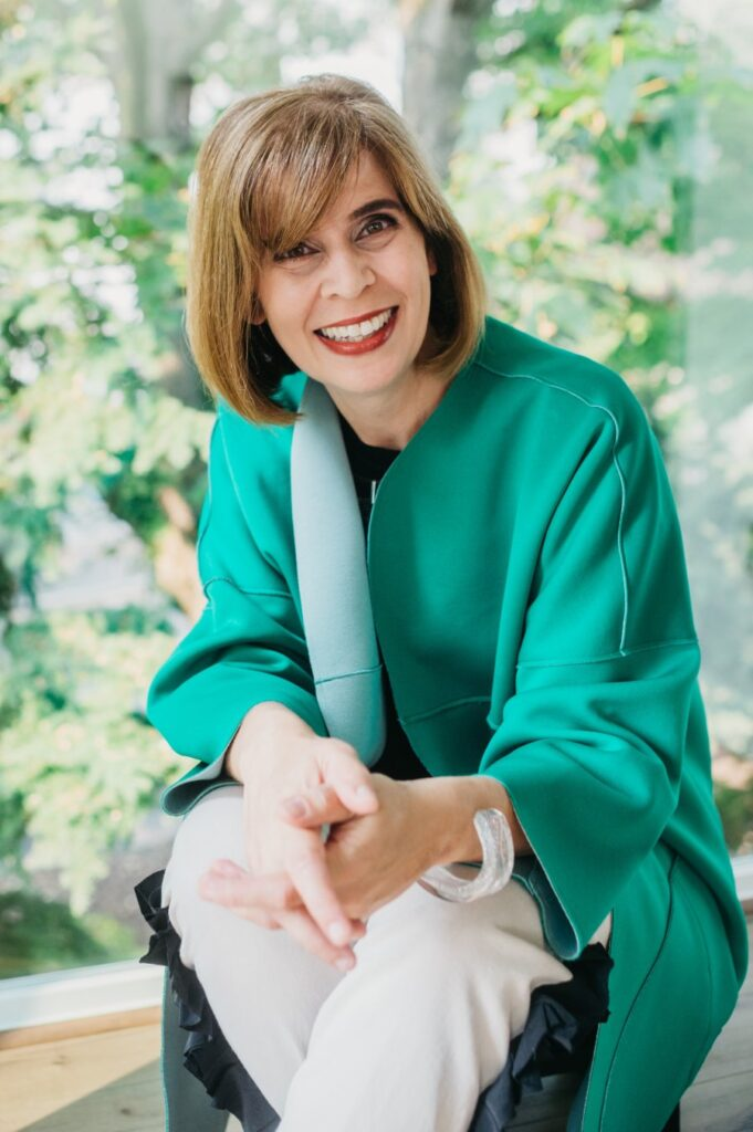 Lisa Kothari, mental health counselor in Capitol Hill, smiles wearing green